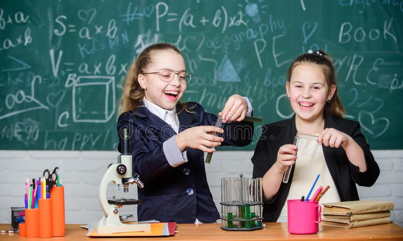 Science experiments in laboratory. Biology lab. Happy Genius. Chemistry research in laboratory. Little girls scientist royalty free stock image