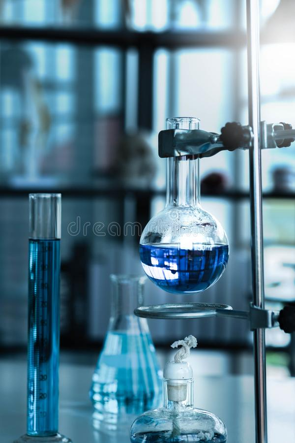 Science Laboratory Different glassware equipment with color liquid test tubes with alcohol glass lamps. stock photo