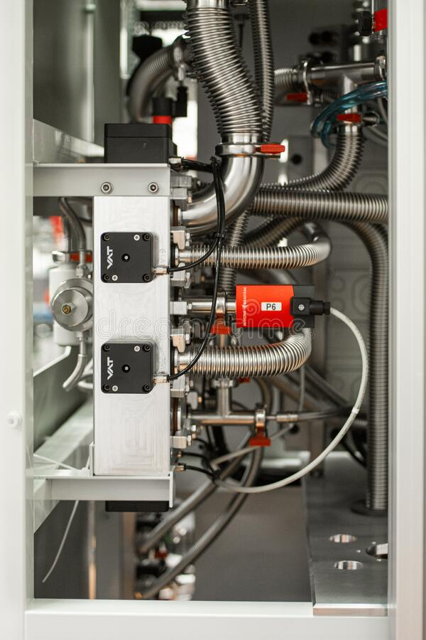 Science laboratory industrial equipment panel piping with cables and flexible aluminum pipes stock photography
