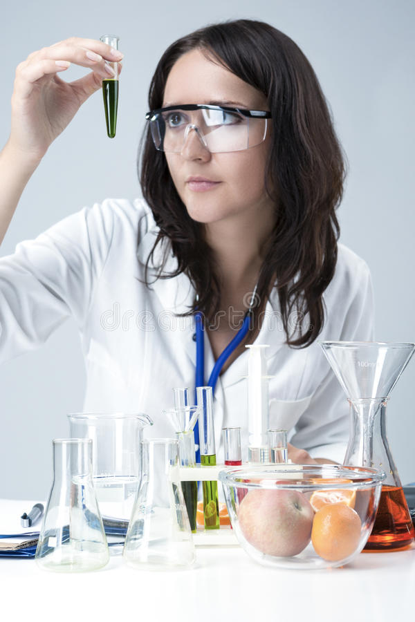 Science and Medicine Concepts. Portrait of Female Lab Staff Dealing With Flasks and Substances in Laboratory stock photo