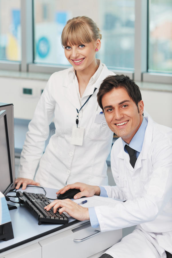 Science people in bright lab royalty free stock photography