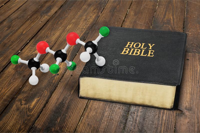 Science and Religion. Evolution Bible Creation creationism Origins Molecule royalty free stock photos