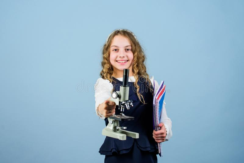 Science research in lab. Small genius girl with microscope. small girl scientist testing. child study bilogy lesson. Discover future. education and knowledge royalty free stock photos