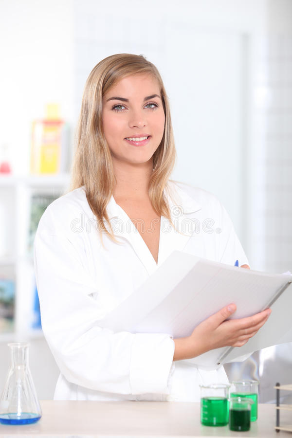 Science student noting results royalty free stock images