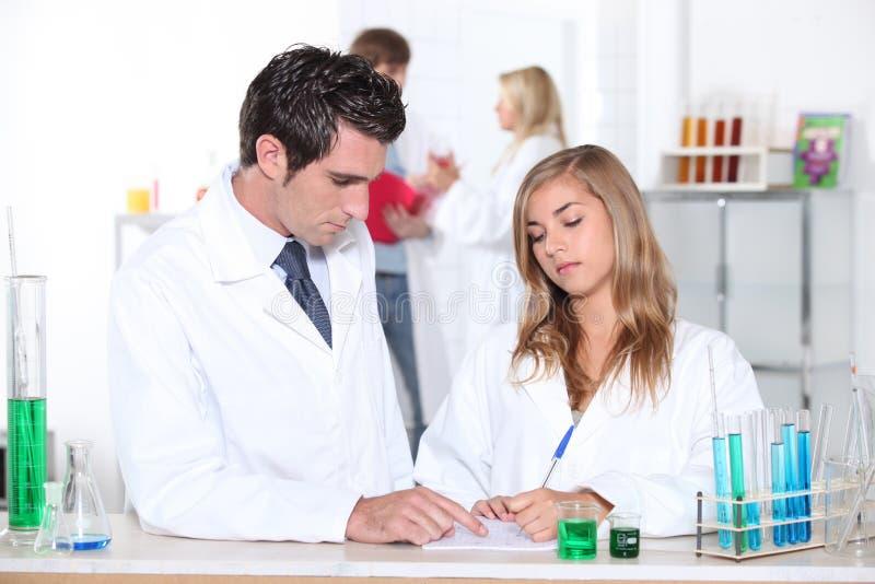 Science teacher helping student stock photo
