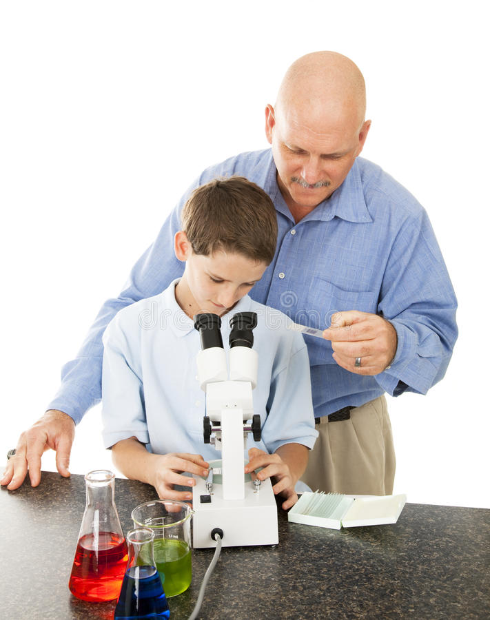 Download Science Teacher Helps Student Stock Photo - Image: 14047550