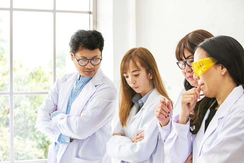 Science Test. Chemist scientific testing quality. Team Scientist working at laboratory. One Man and Three woman at chemistry lab. royalty free stock images