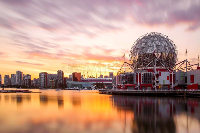 Science World and Downtown Vancouver at Sunset in Summer. A long exposure at Sunset of Science World and downtown Vancouver shot from False Creek, on a warm royalty free stock photo