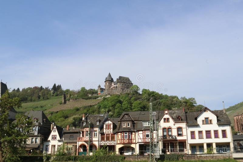 Scenic view at historic half-timbered houses and castle on hilltop stock photos