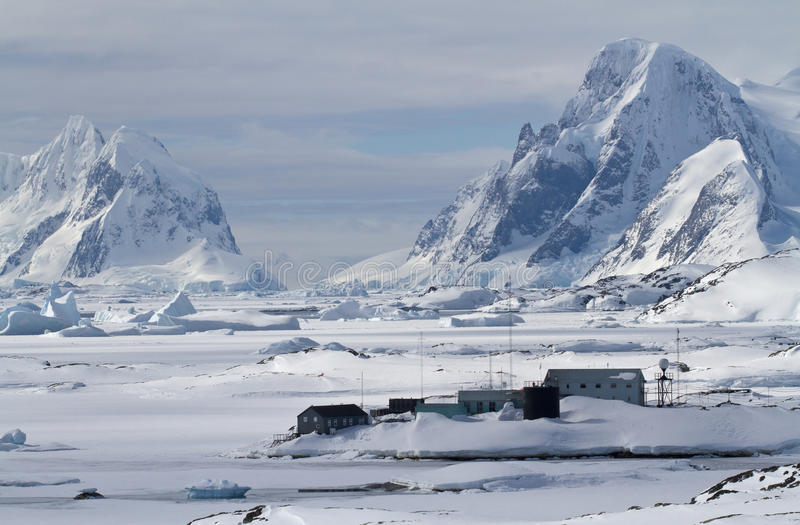 Scientific Antarctic station winter day on a background of mount stock images