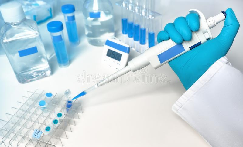 Scientific background in blue and white with automatic pipette royalty free stock images