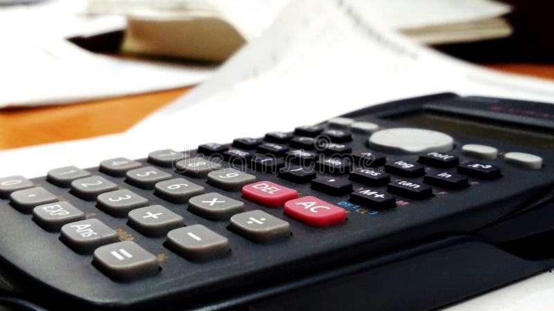 Scientific Calculator in classroom for mathamatics. It is a Scientific Calculator used by Technical students. It can solve 400+ functions stock photo