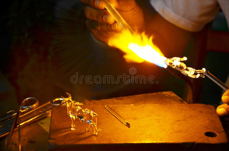 Scientific glass blowing. Glassblowing is a glassforming technique that involves inflating molten glass into a bubble (or parison), with the aid of a blowpipe ( royalty free stock image