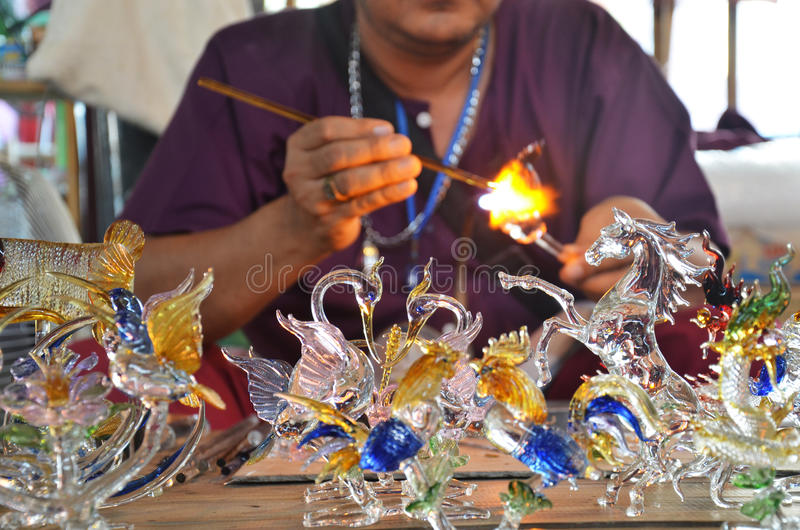 Scientific Glass blowing and working thai style in thailand. Glassblowing is a glassforming technique that involves inflating molten glass into a bubble (or stock images