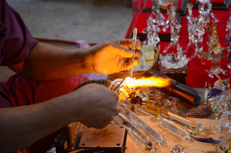 Scientific Glass blowing and working thai style in thailand. Glassblowing is a glassforming technique that involves inflating molten glass into a bubble (or stock photography