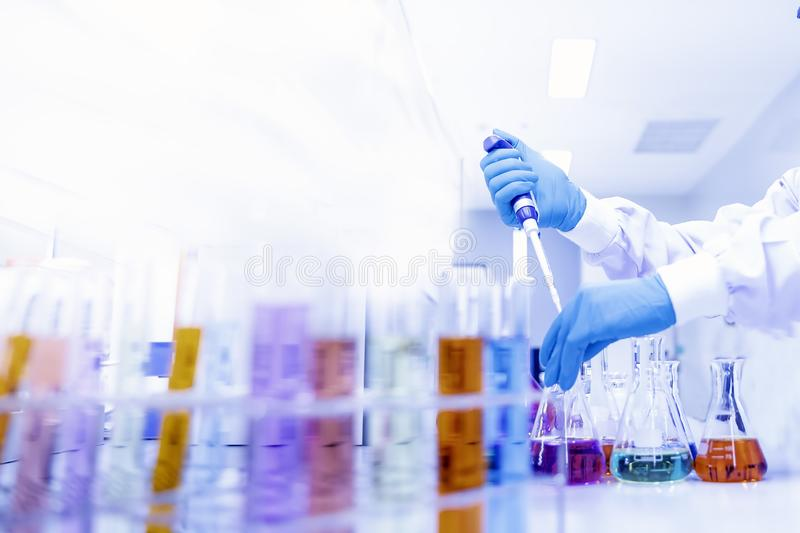 Scientific Glassware For Chemical,Laboratory Research Analysis Laboratory - Scientist With Pipette And Beaker - Equipment Chemical.  royalty free stock photos