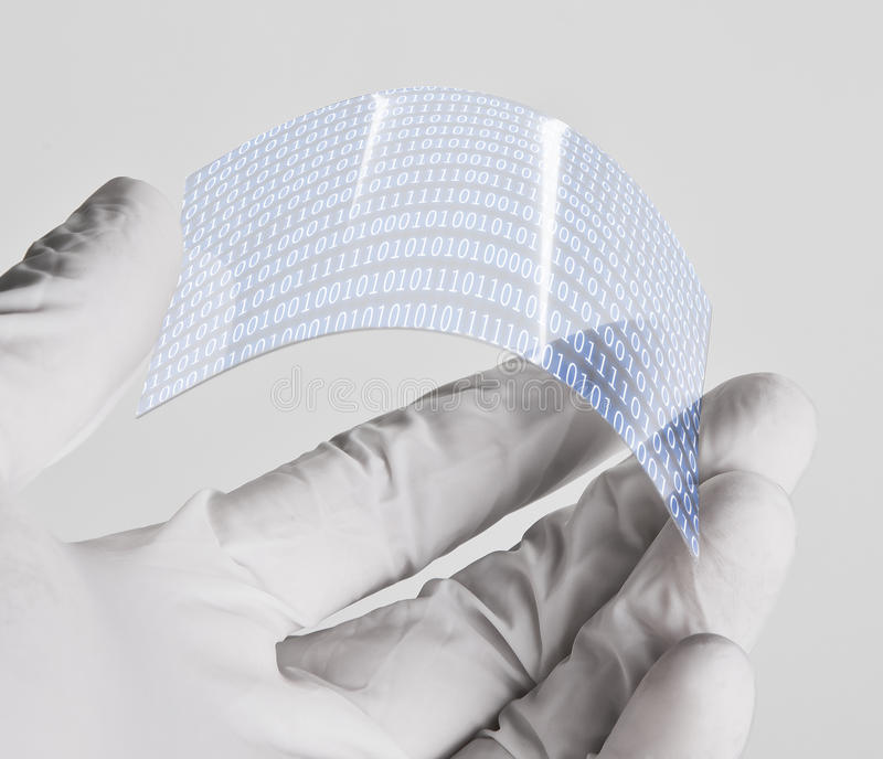 Scientific holding one piece transparent of graphene application with binary numbers concept. stock images