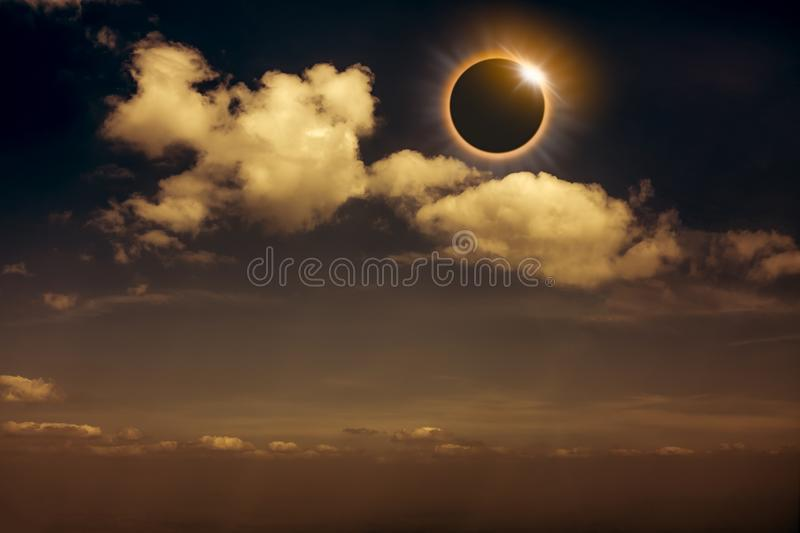 Scientific natural phenomenon. Total solar eclipse with diamond. Scientific natural phenomenon. The Moon covering the Sun. Total solar and lunar eclipse with stock photos