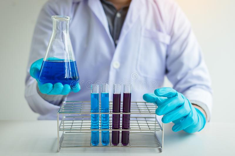 Scientific researcher holding chemical substance in laboratory. royalty free stock image