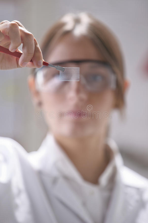 Scientific showing a piece of graphene with binary numbers. Transparent of graphene application stock images