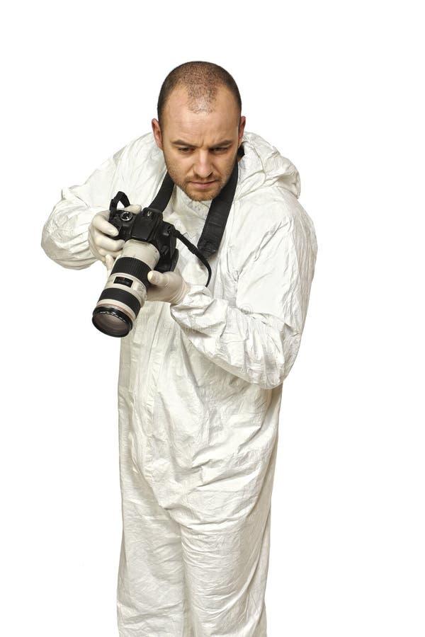 Scientifique de police avec l'appareil-photo photo libre de droits