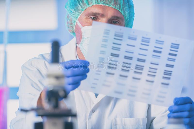 Scientist analizing DNA sequence stock images