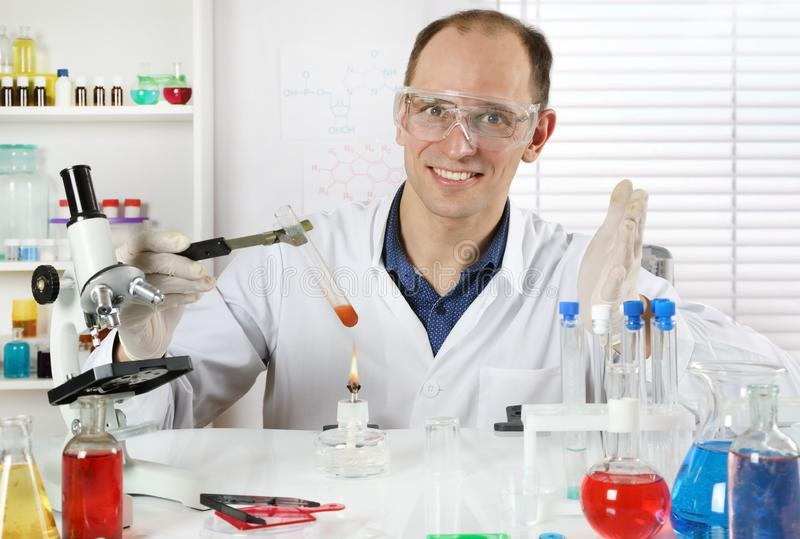 Scientist in the chemical laboratory stock photography
