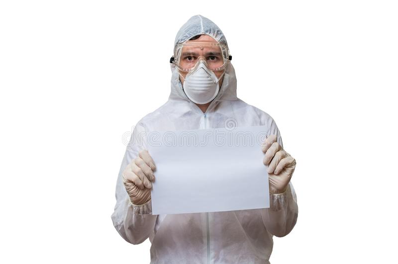 Scientist in coveralls is holds blank paper for custom text. On white background stock photos