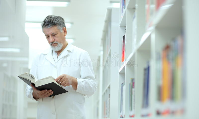 Download Scientist/doctor In A Library Stock Photo - Image: 14040202