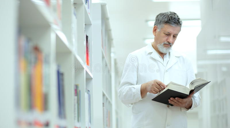 Download Scientist/doctor In A Library Stock Photo - Image of expertise, bright: 14041638