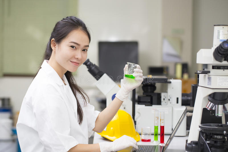 Scientist doing chemical test in laboratory royalty free stock images