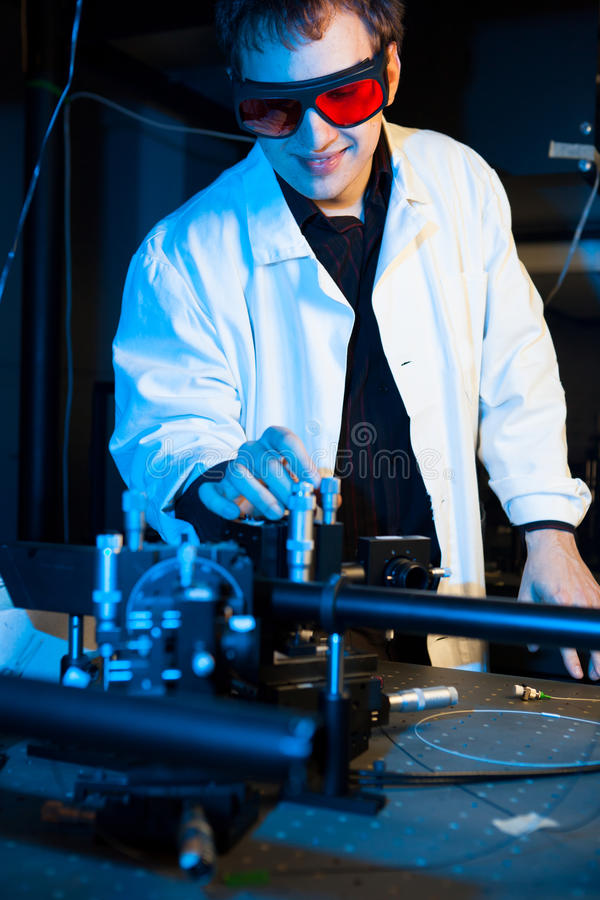 Scientist doing research in a quantum optics lab. (shallow DOF; color toned image royalty free stock photo