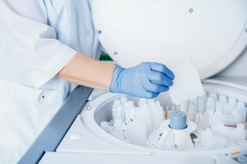 Scientist downloads blood samples to test dna, hiv, aids, virus on laboratory.  stock image