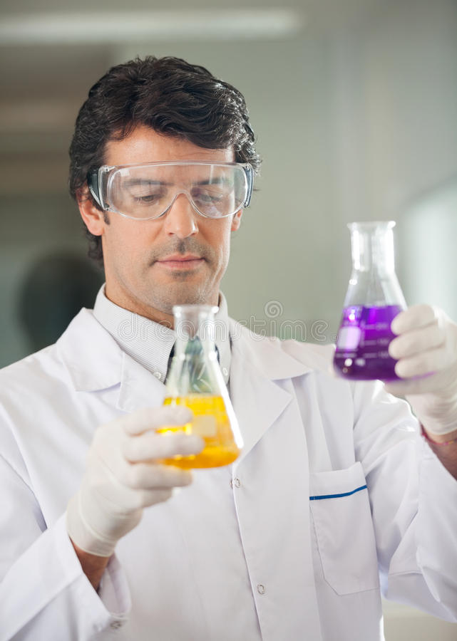Scientist Examining Flasks With Different royalty free stock images