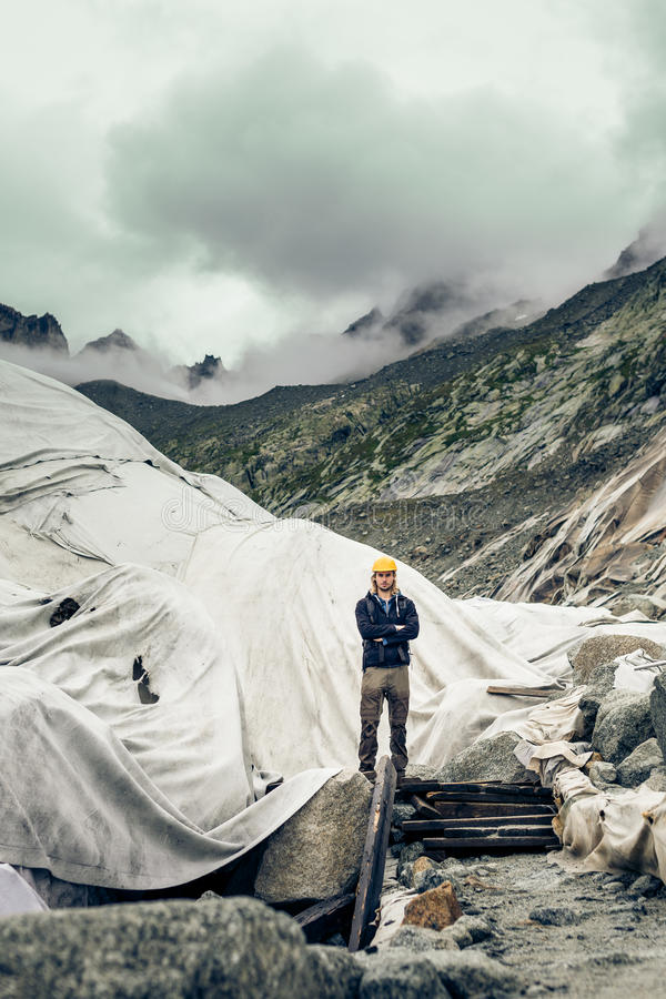 Scientist At An Expedition Site Examining A Glacier stock photography