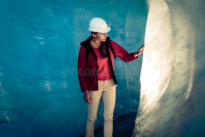 Scientist At An Expedition Site Examining A Glacier royalty free stock photos