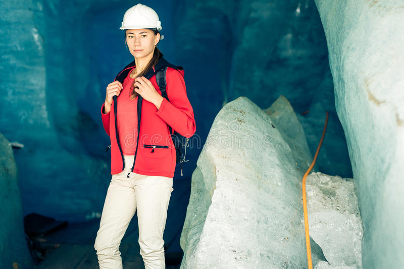 Scientist At An Expedition Site Examining A Glacier stock image