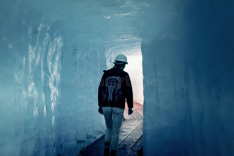 Scientist At An Expedition Site Examining A Glacier royalty free stock photography