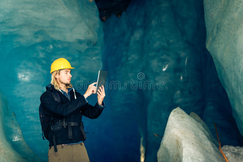 Scientist At An Expedition Site Examining A Glacier stock images
