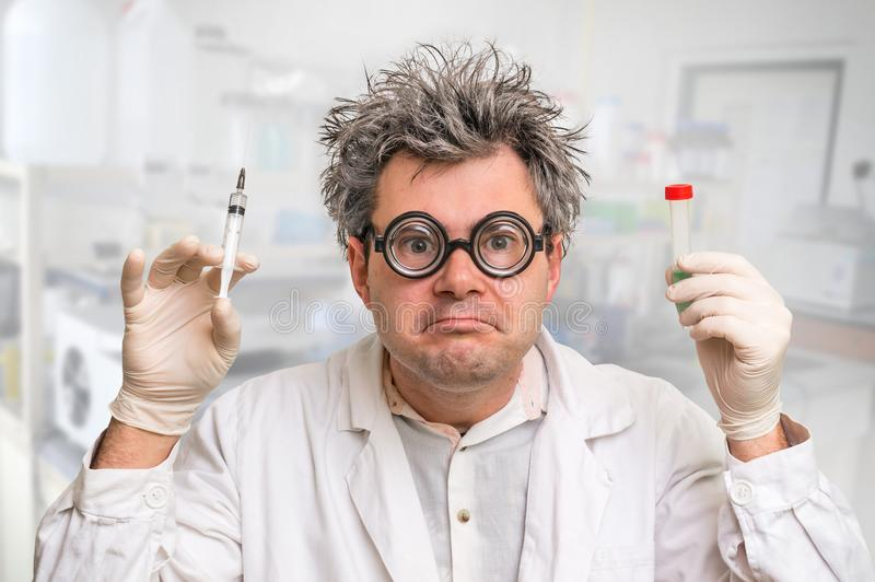 Scientist with gray hair performing experiments in laboratory stock images