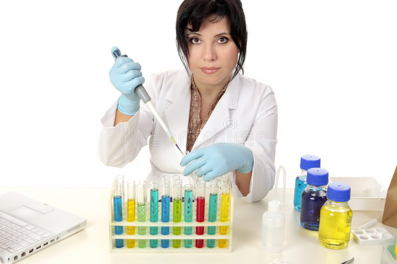 Scientist in laboratory. Using a pipette, test tubes and chemicals royalty free stock image