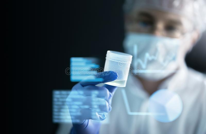 Scientist in laboratory doing medical research with future health care technology. AR screen and futuristic interface. royalty free stock photos