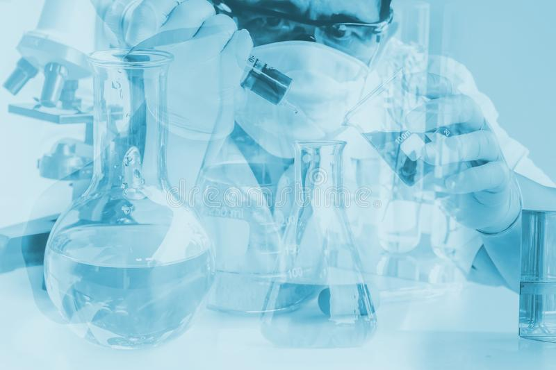 Scientist in laboratory to research with test tube , science con royalty free stock photos