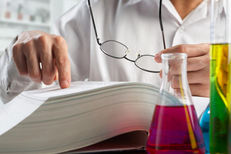 Scientist looking for data in journal royalty free stock photography