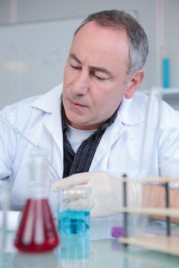 Scientist looking at test-tube royalty free stock photo
