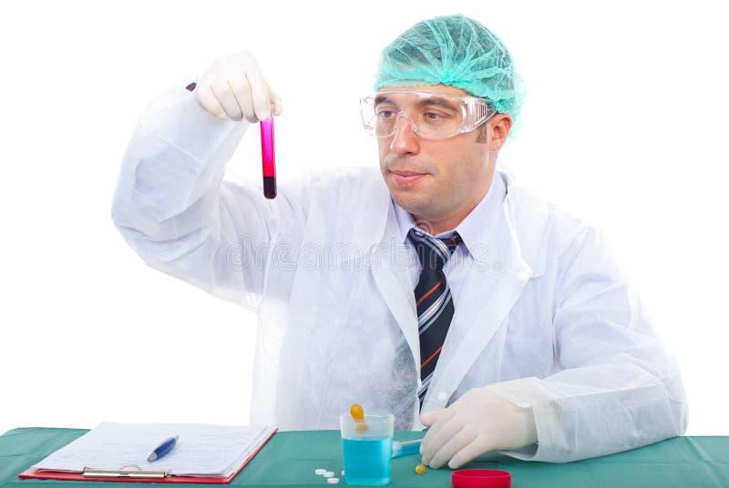 Scientist man examine blood tube stock photography