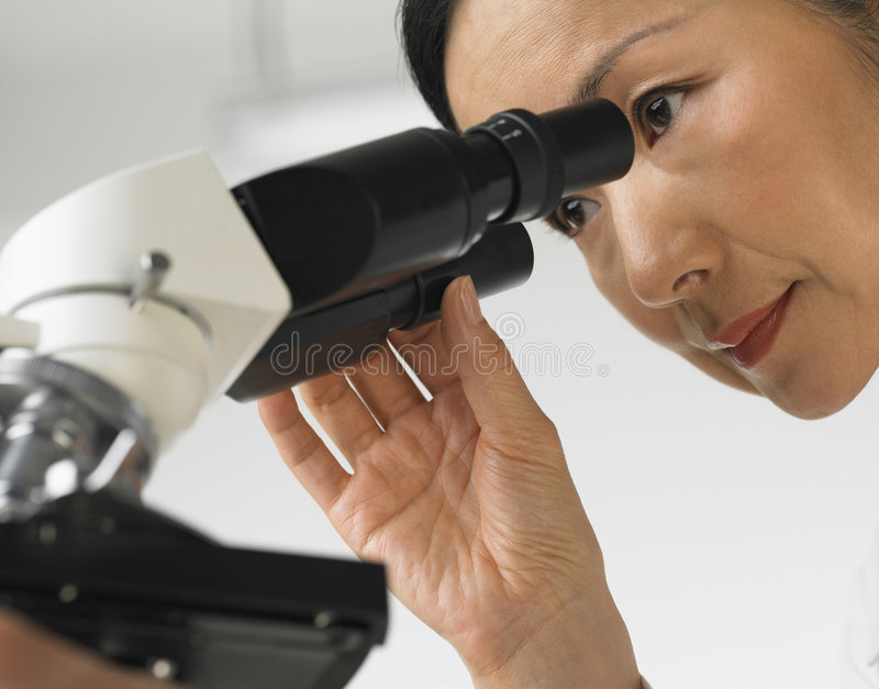 Scientist and microscope royalty free stock images
