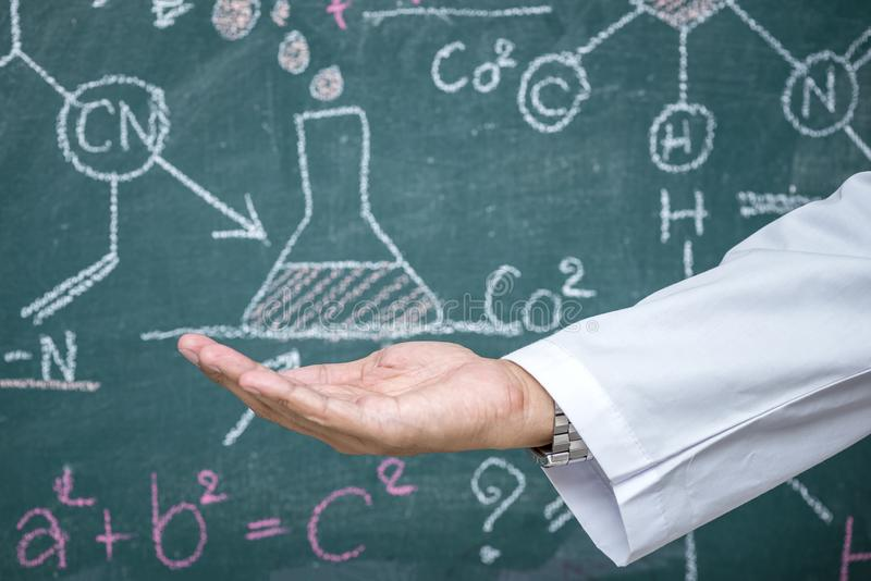 Scientist open the palm of the hand and formulas stock image