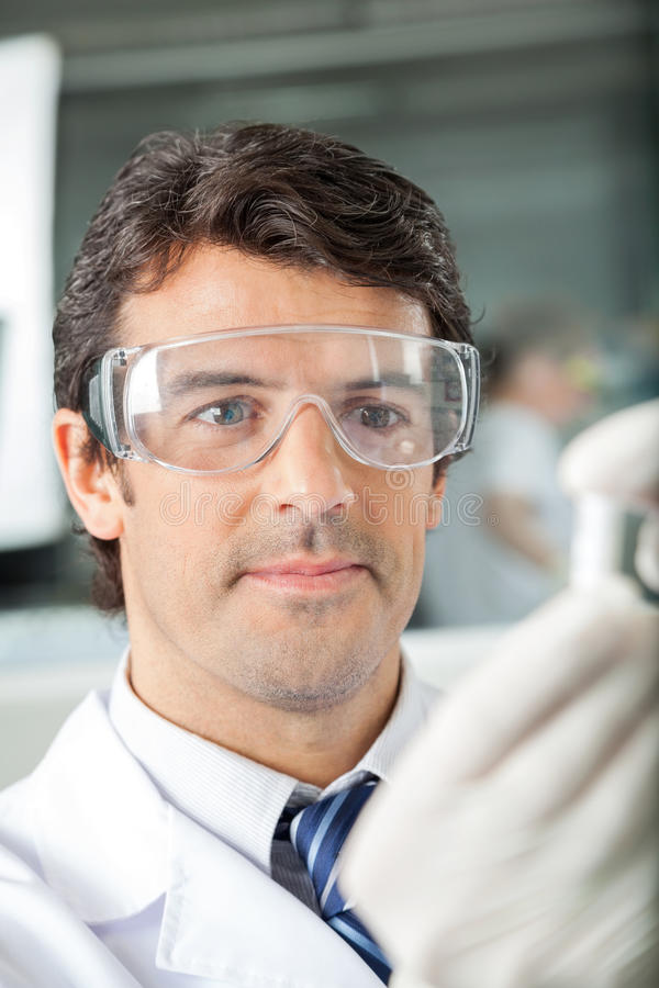 Scientist In Protective Eyewear At Laboratory stock images