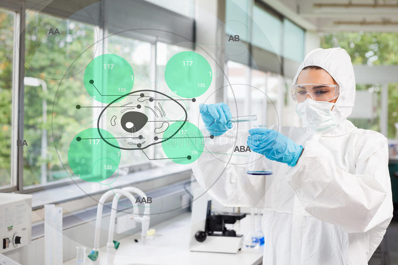 Scientist in protective suit working with green cell diagram int. Erface in the lab royalty free stock photo